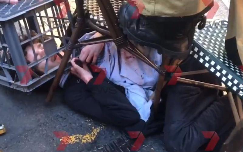 Screengrab from a video issued by 7 News of a man being tackled with a milk crate and chairs by members of the public in Sydney - PA