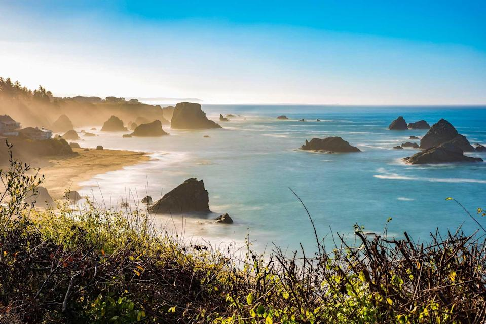 Morning mist rising from Harris Beach, near Brookings, Oregon. The rock formations add to the views looking out at the Pacific Ocean