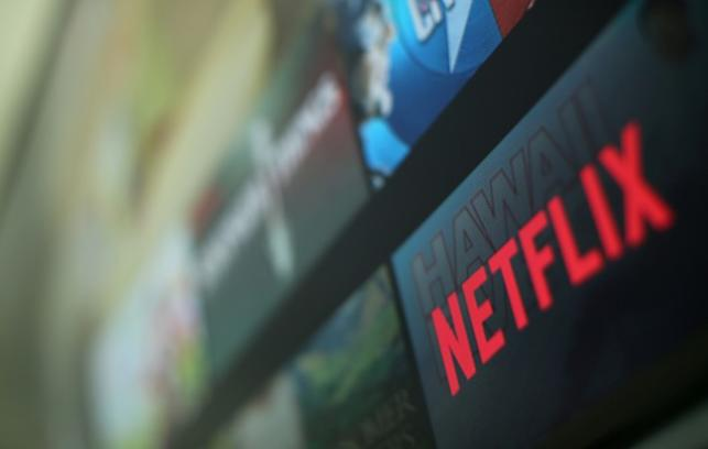 The Netflix logo is pictured on a television