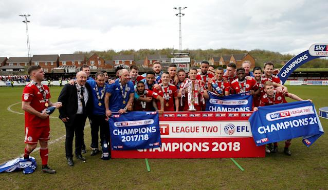 "Soccer Football - League Two - Accrington Stanley v Lincoln City - Wham Stadium, Accrington, Britain - April 28, 2018 Accrington Stanley players celebrate with the trophy after winning League Two Action Images/Andrew Boyers EDITORIAL USE ONLY. No use with unauthorized audio, video, data, fixture lists, club/league logos or ""live"" services. Online in-match use limited to 75 images, no video emulation. No use in betting, games or single club/league/player publications. Please contact your account representative for further details."