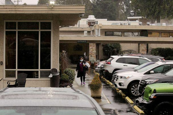 PHOTO: A worker leaves the Life Care Center of Kirkland, the long-term care facility linked to several confirmed coronavirus cases in the state, in Kirkland, Wash., March 2, 2020. (David Ryder/Reuters)