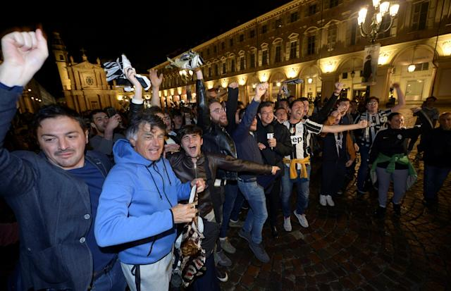 Soccer Football - Serie A - AS Roma vs Juventus - Turin, Italy - May 13, 2018. Juventus' supporters celebrate after winning the league. REUTERS/Massimo Pinca