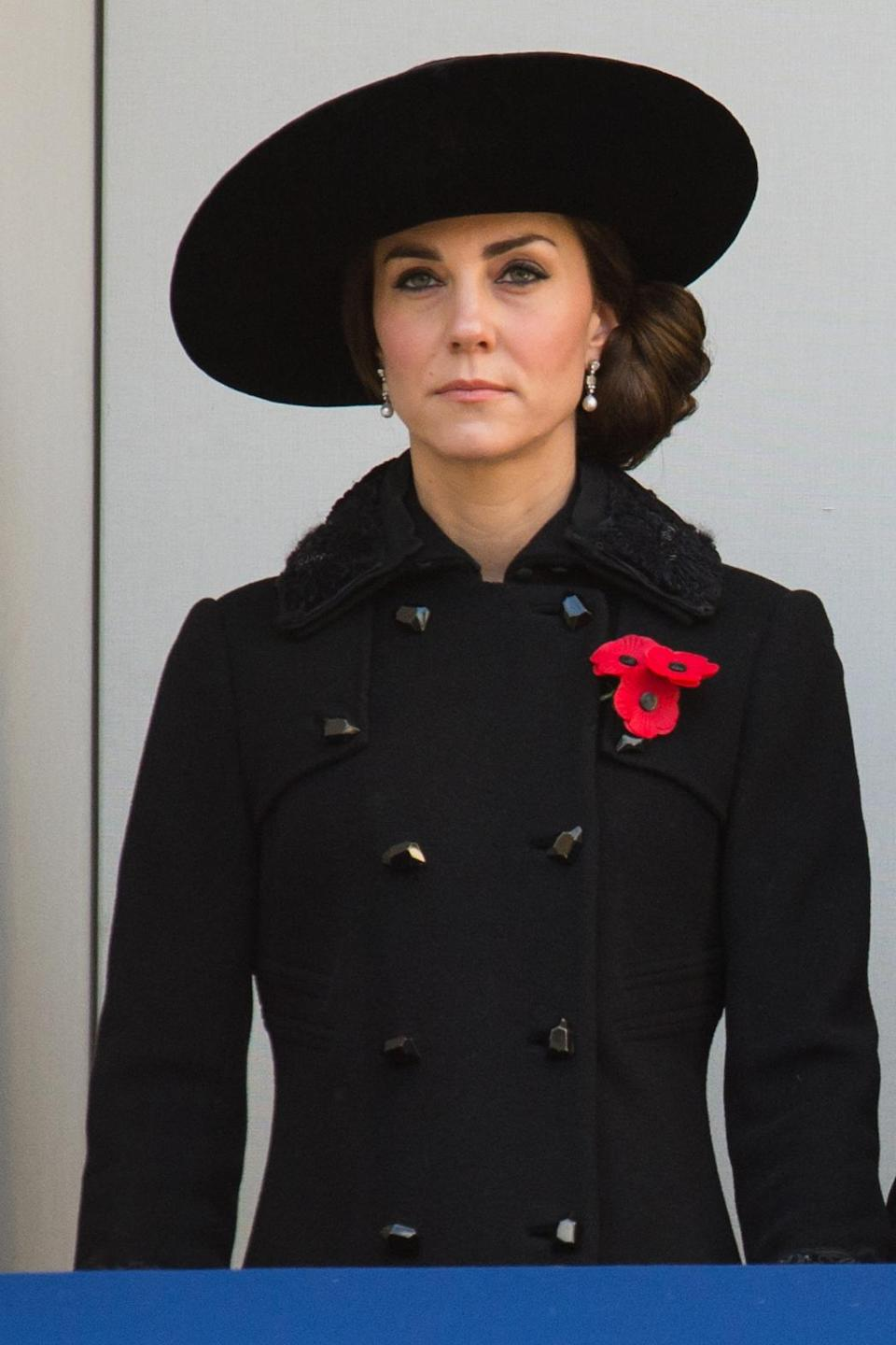 <p>For Remembrance Sunday, Kate wore a suitably sombre look. Dressed entirely in black, she joined other members of the royal family for the service in a buttoned black coat and matching wide-brimmed hat.</p><p><i>[Photo: PA]</i></p>