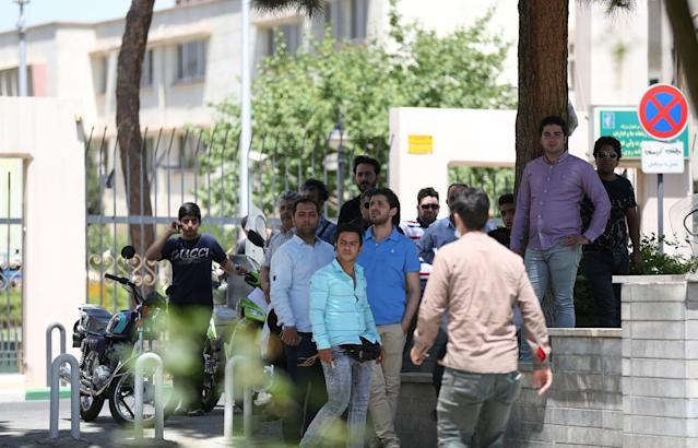 <p>People gather near the parliament's building during a gunmen attack in central Tehran, Iran, June 7, 2017. (Photo: TIMA via Reuters) </p>