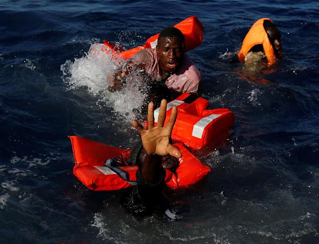 <p>APR. 14, 2017 – Migrants try to stay afloat after falling off their rubber dinghy during a rescue operation by the Malta-based NGO Migrant Offshore Aid Station (MOAS) ship in the central Mediterranean in international waters some 15 nautical miles off the coast of Zawiya in Libya. All 134 sub-Saharan migrants survived and were rescued by MOAS. (Photo: Darrin Zammit Lupi/Reuters) </p>
