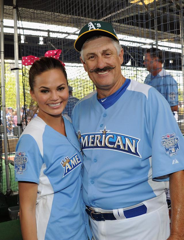 KANSAS CITY, MO - JULY 08: Model Chrissy Teigen and former MLB player Rollie Fingers attend the 2012 Taco Bell All-Star Legends & Celebrity Softball Game at Kauffman Stadium on July 8, 2012 in Kansas City, Missouri. (Photo by Rick Diamond/Getty Images)