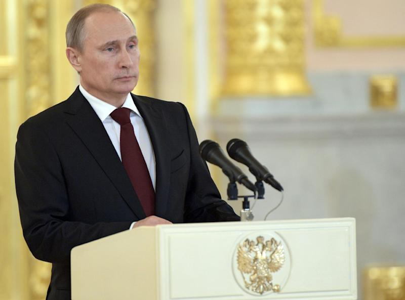 Russia's President Vladimir Putin attends a ceremony at the Grand Kremlin Palace in Moscow, on June 27, 2014