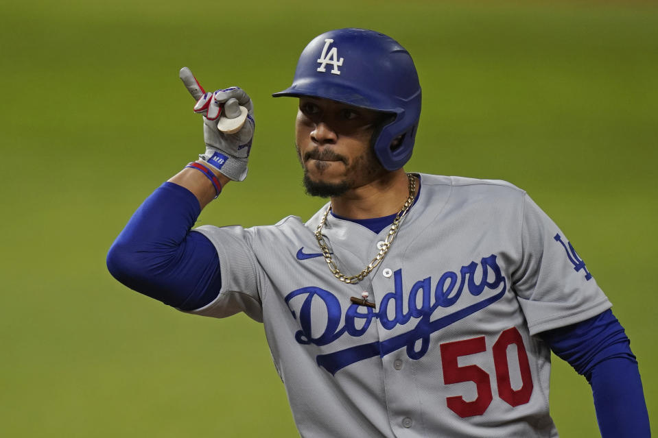 Los Angeles Dodgers' Mookie Betts celebrates his RBI single against the Tampa Bay Rays during the fourth inning in Game 3 of the baseball World Series Friday, Oct. 23, 2020, in Arlington, Texas. (AP Photo/Eric Gay)