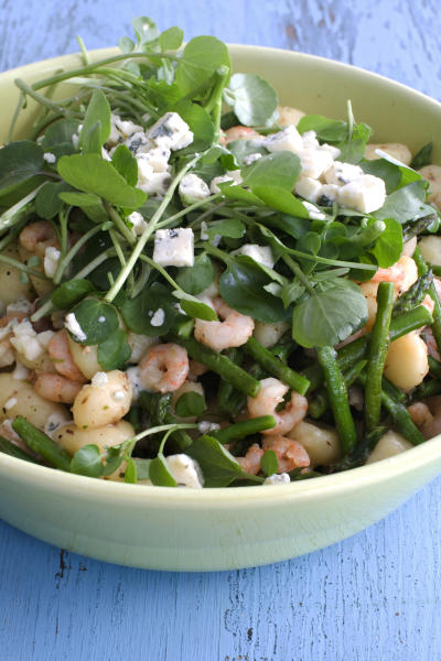In this image taken on March 18, 2013, spring gnocchi with asparagus and shrimp is shown in a serving bowl in Concord, N.H. (AP Photo/Matthew Mead)