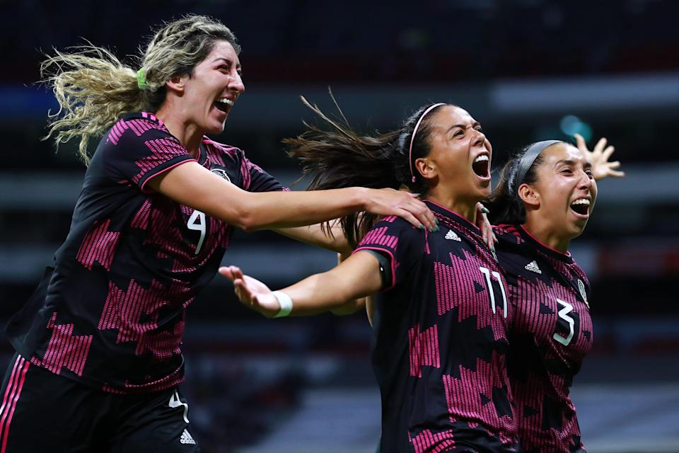 Maria Sanchez of Mexico celebrates with teammates after scoring the second goal of her team against Colombia.
