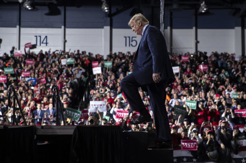 FILE - In this Wednesday, Dec. 18, 2019 file photo, President Donald Trump arrives at W.K. Kellogg Airport to attend a campaign rally in Battle Creek, Mich. (AP Photo/Evan Vucci, File)