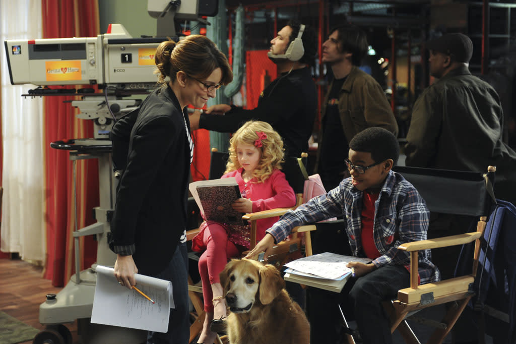 "30 ROCK -- ""Part 1: Hogcock! Part 2: Last Lunch"" Episode 712/713 -- Pictured: (l-r) Tina Fey as Liz Lemon, Marina Bond as Janet, Dante Hoagland as Terry"