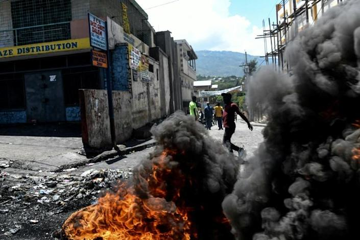 Hundreds of people flooded the streets in Port-au-Prince to protest against Haitian President Jovenel Moise (AFP Photo/CHANDAN KHANNA)