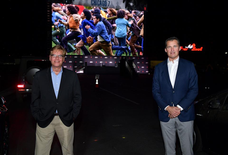 "PASADENA, CALIFORNIA - OCTOBER 13: (L-R) Aaron Sorkin and Scott Stuber, Vice President of Original Films at Netflix attend Netflix's ""The Trial of the Chicago 7"" Los Angeles Drive In Event at the Rose Bowl on October 13, 2020 in Pasadena, California. (Photo by Matt Winkelmeyer/Getty Images for Netflix)"
