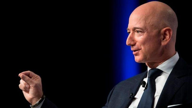 Jeff Bezos demonstrates how he'll turn the little spaceship knobs during his flight.