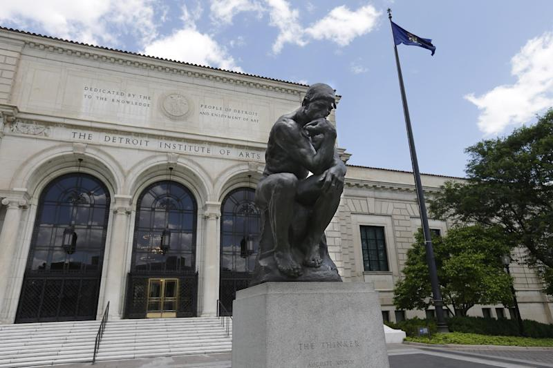 In a June 13, 2013 photo, The Thinker, by Rodin is displayed outside the Detroit Institute of Arts in Detroit. In a quest to balance the budget in cash-strapped Detroit, the city's emergency manager is proposing a controversial idea: sell the city's art. (AP Photo/Carlos Osorio)