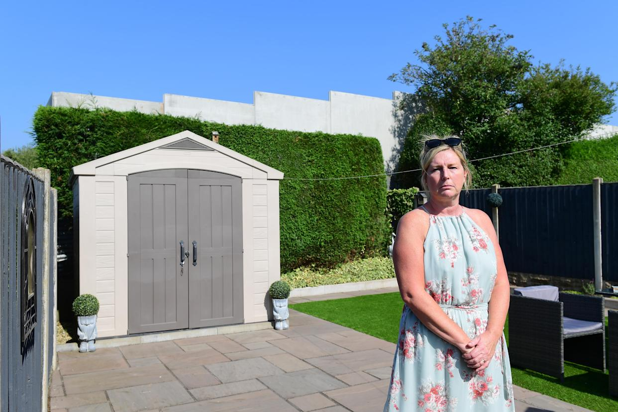 The 'eyesore' structure towers over Sharon Everill's property in Staffordshire. (Reach)