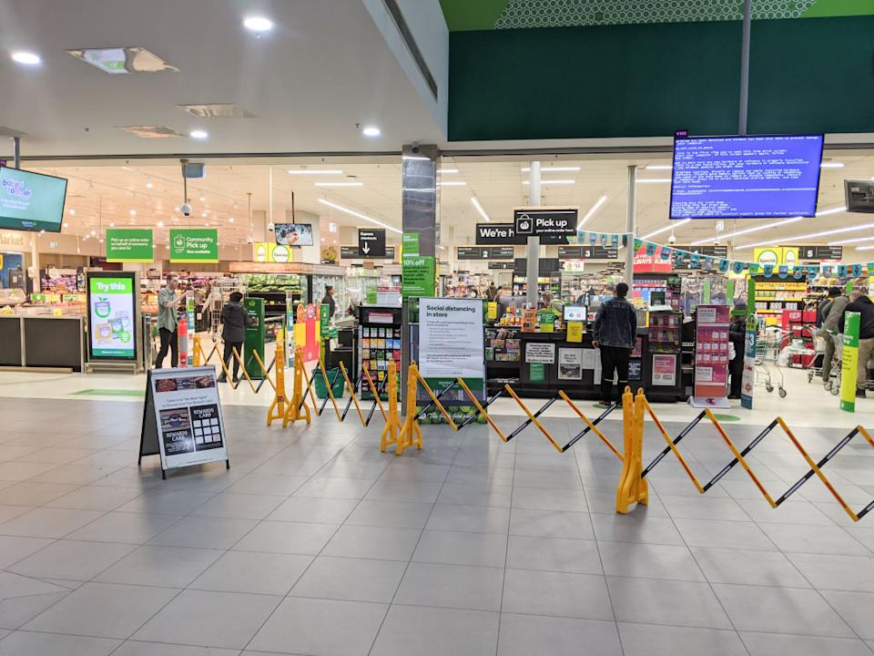 The front entrance of a Woolworths supermarket which is practising social distancing rules.