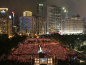 FILE - In this June 4, 2011, file photo, thousands of people attend a candlelight vigil in Hong Kong's Victoria Park to mark the anniversary of the military crackdown on a pro-democracy student movement in Beijing. (AP Photo/Kin Cheung, File)