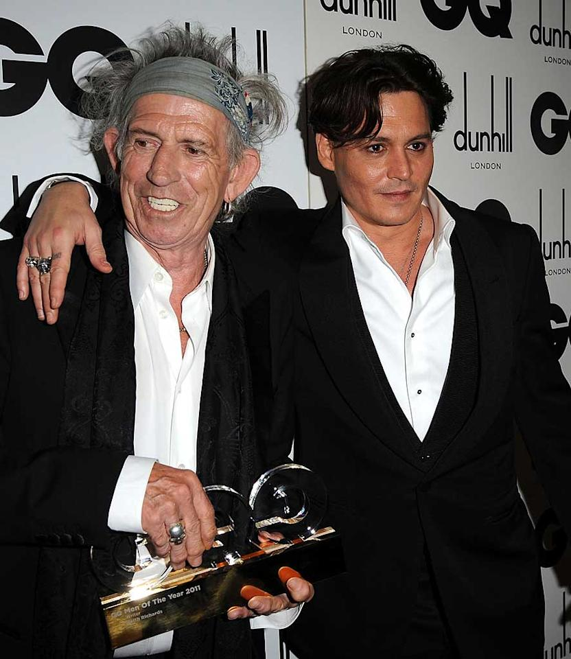"""An unusually clean shaven Johnny Depp and Rolling Stones guitarist Keith Richards buddied up on the red carpet. And for those debating whether to spend the money on a master's degree in creative writing, you might want to note that Richards was the one who walked away with the night's Writer award for his memoir! Eamonn McCormack/<a href=""""http://www.wireimage.com"""" target=""""new"""">WireImage.com</a> - September 6, 2011"""