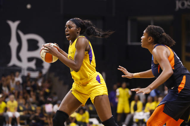 FILE - In this Sunday, Sept. 22, 2019, file photo, Los Angeles Sparks' Chiney Ogwumike (13) drives past Connecticut Sun's Morgan Tuck (33) during the second half of Game 3 of a WNBA basketball playoff game in Long Beach, Calif. The Los Angeles Sparks will be without Ogwumike and Kristi Toliver for the WNBA season so they can focus on their health the team announced Friday, June 26, 2020. (AP Photo/Ringo H.W. Chiu, File)