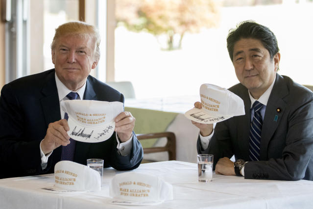 "<p>President Donald Trump and Japanese Prime Minister Shinzo Abe hold up hats they have both signed that read ""Donald and Shinzo, Make Alliance Even Greater"" at Kasumigaseki Country Club, Sunday, Nov. 5, 2017, in Kawagoe, Japan. (Photo: Andrew Harnik/AP) </p>"