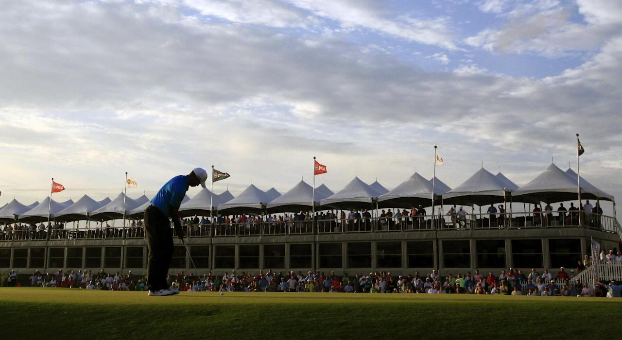 Tiger Woods putts on the 18th green during the second round of the PGA Championship golf tournament on the Ocean Course of the Kiawah Island Golf Resort in Kiawah Island, S.C., Friday, Aug. 10, 2012. (AP Photo/Chuck Burton)