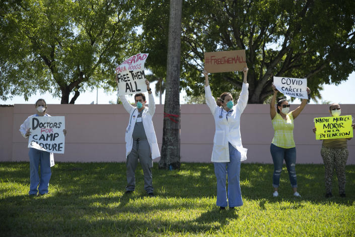 Protesters stand outside ICE's Broward Transitional Center in Pompano Beach, Fla.