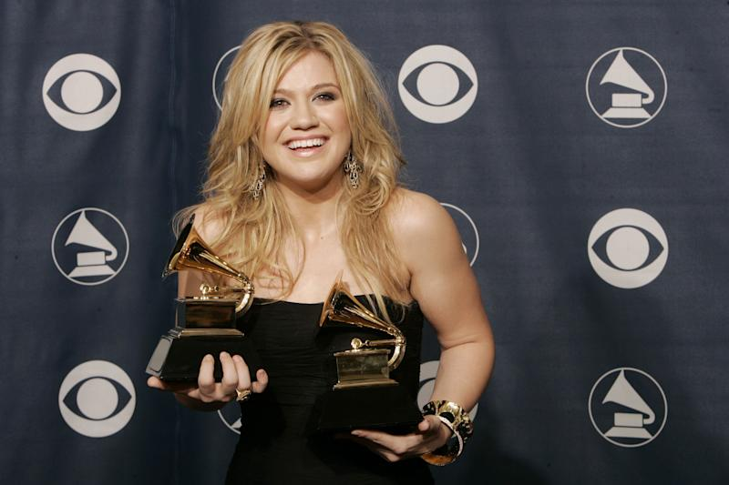 "Kelly Clarkson poses with the two Grammy awards she won for her album ""Breakaway."""