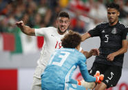 Mexico goalkeeper Guillermo Ochoa, front, makes a save as Canada forward Lucas Cavallini, back left, fights his way past Mexico defender Diego Reyes during the first half of a CONCACAF Gold Cup soccer match Wednesday, June 19, 2019, at Mile High Stadium in Denver. (AP Photo/David Zalubowski)