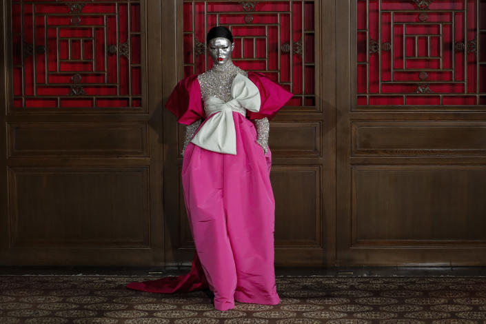 In this Thursday, Nov. 7, 2019, file photo, a model presents a creation from Valentino Haute Couture collection by designer Pierpaolo Piccioli during a fashion show at the Aman Summer Palace in Beijing. (AP Photo/Andy Wong, File)