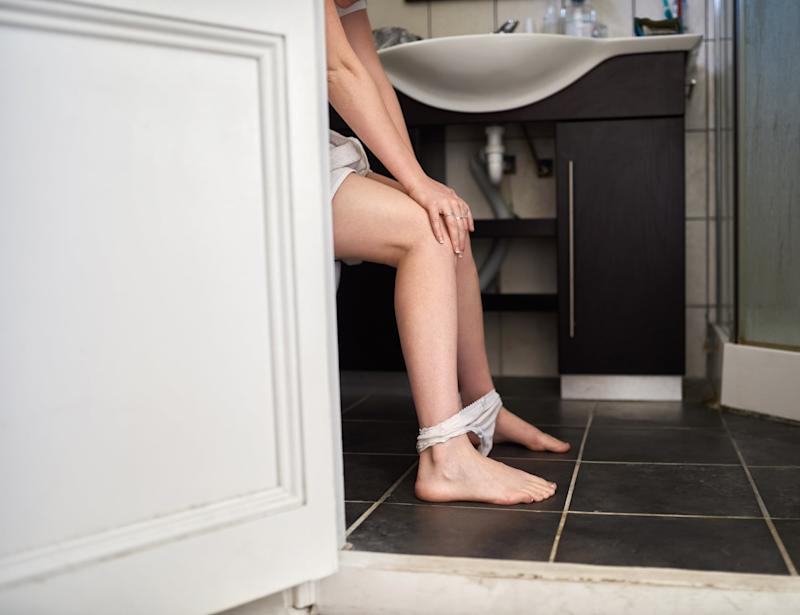 Shot of an unrecognizable woman using the toilet at home