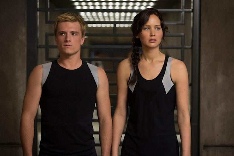 "This image released by Lionsgate shows Josh Hutcherson as Peeta Mellark, left, and Jennifer Lawrence as Katniss Everdeen in a scene from ""The Hunger Games: Catching Fire."" The movie opens in theaters Friday, Nov. 22, 2013, in what's expected to be one of the year's biggest box-office debuts. (AP Photo/Lionsgate, Murray Close)"