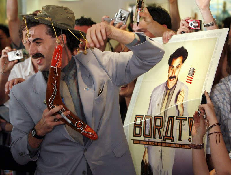 FILE PHOTO: British actor Sacha Baron Cohen, in character as a Kazakh TV reporter known as 'Borat', holds a boomerang as he mingles with fans at his film's premiere in Sydney