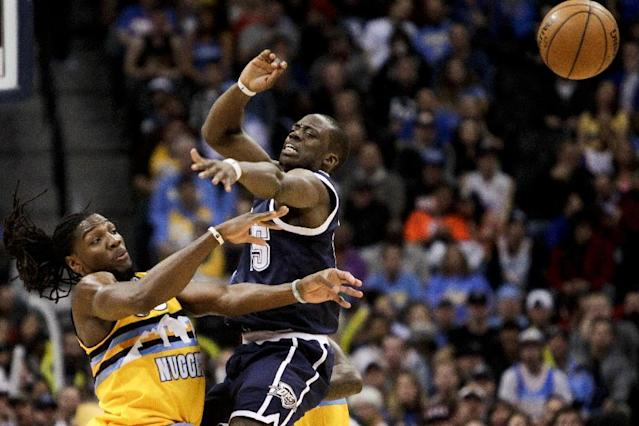 Denver Nuggets' Kenneth Faried, left, is fouled by Oklahoma City Thunder's Reggie Jackson, right, during the first quarter of an NBA basketball game Thursday, Jan. 9, 2014, in Denver. (AP Photo/Barry Gutierrez)