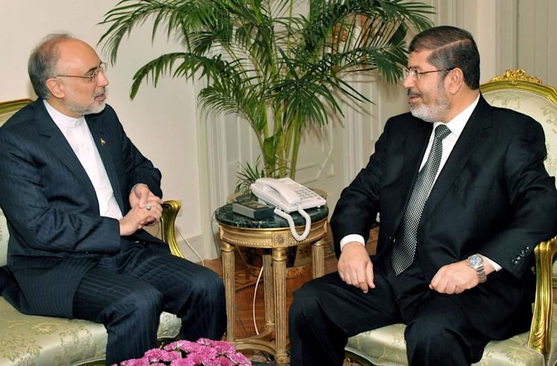 In this image released by the Egyptian President, Egyptian President Mohammed Morsi, right, meets with Iranian Foreign Minister Ali Akbar Salehi at the Presidential Palace in Cairo, Egypt, Tuesday, Sept. 18, 2012. (AP Photo/Egyptian Presidency)