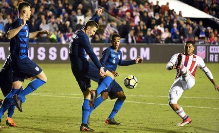 Mar 27, 2018; Cary, NC, USA; United States forward Andrija Novakovich (18) clears the ball in front of Paraguay midfielder Richard Ortiz (6) during the second half of an international friendly men's soccer match at WakeMed Soccer Park. The US won 1-0. Rob Kinnan-USA TODAY Sports