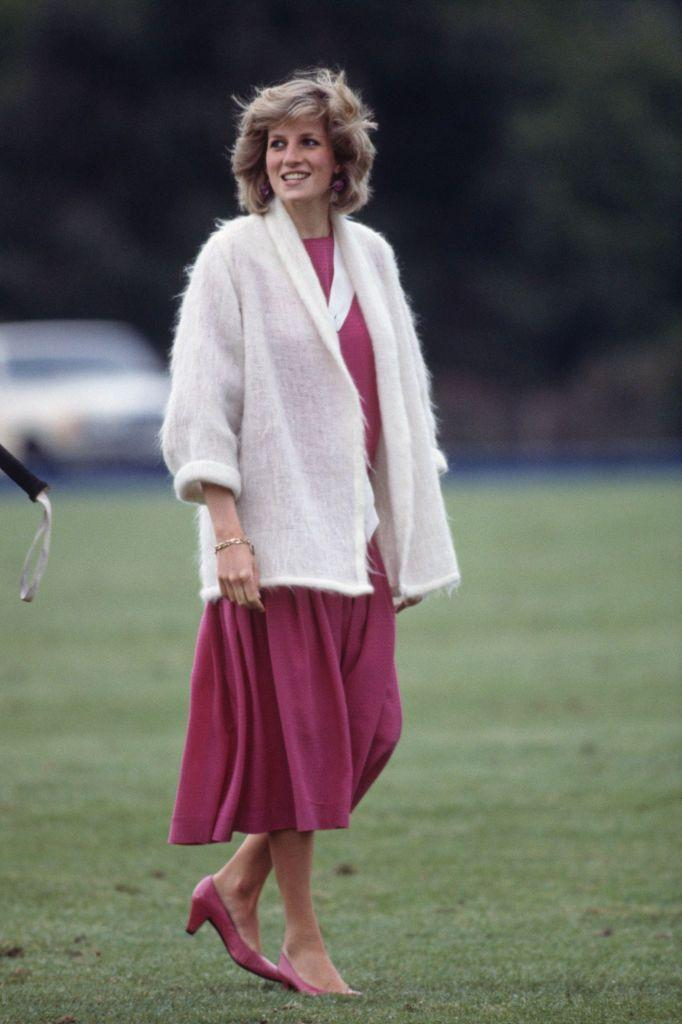 <p>Once again, polo matches gave Diana a chance to show off her more casual maternity style—such as this pink dress and cozy sweater, from June 1984.<br></p>