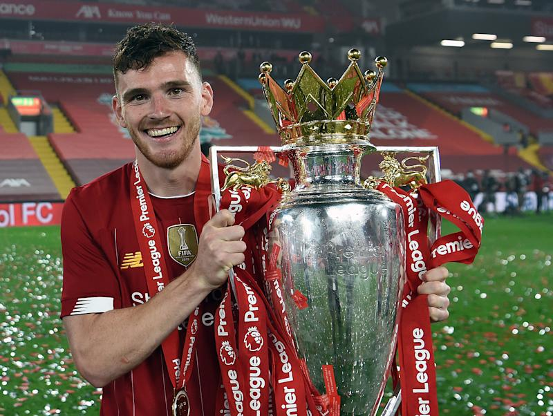 Liverpool full-back Andy Robertson with the Premier League trophyLiverpool FC via Getty Images