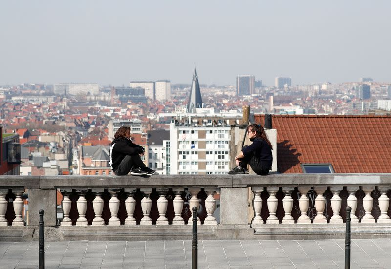 People practice social distancing at a viewpoint in central Brussels
