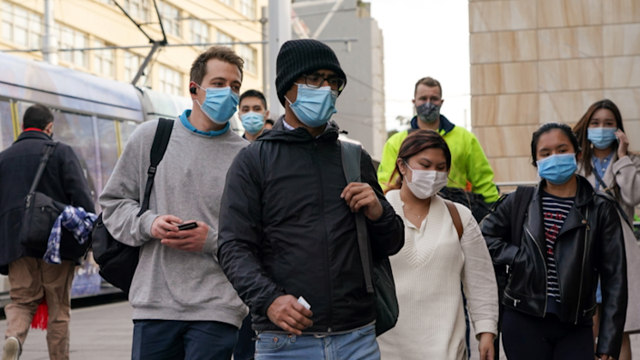 Sydney commuters wearing masks entering Central train station on Wednesday