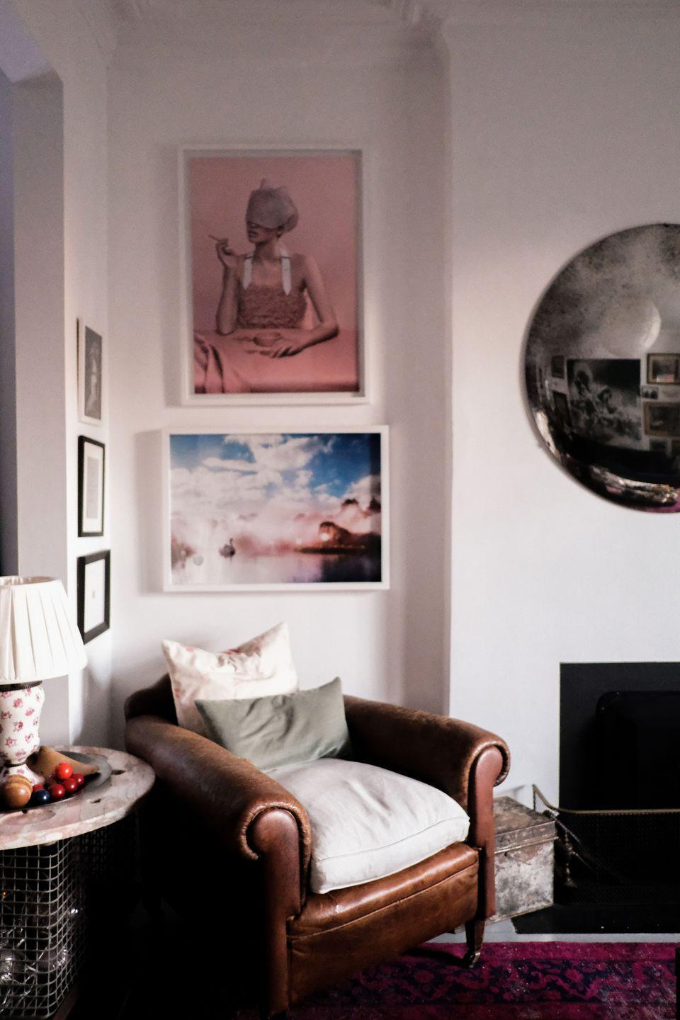 """<p>""""The pink portrait is one of the first pieces of art we bought together - it's by Carolina Mizrahi,"""" says Angus. """"The image of the swan lake was taken at our wedding by our good friend, the photographer Alex Bramall, he sweetly gave it to us framed as a wedding gift. We love the antique leather chair which was bespoke made for a 1940s gentleman who was almost seven-foot tall which is why it is abnormally deep. It made an amazing day bed for both our children to nap in when they were babies.""""</p>"""