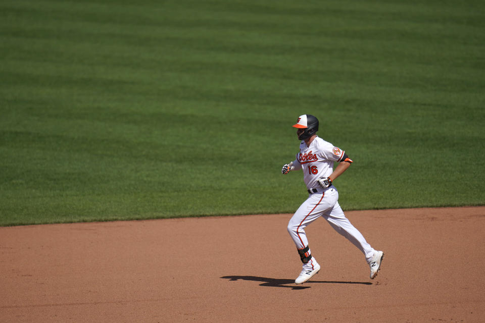 Baltimore Orioles' Trey Mancini runs the bases after hitting a three-run home run off Boston Red Sox relief pitcher Austin Brice during the seventh inning of a baseball game, Sunday, April 11, 2021, in Baltimore. Orioles Ramon Urias and Cedric Mullins scored on the home run. (AP Photo/Julio Cortez)