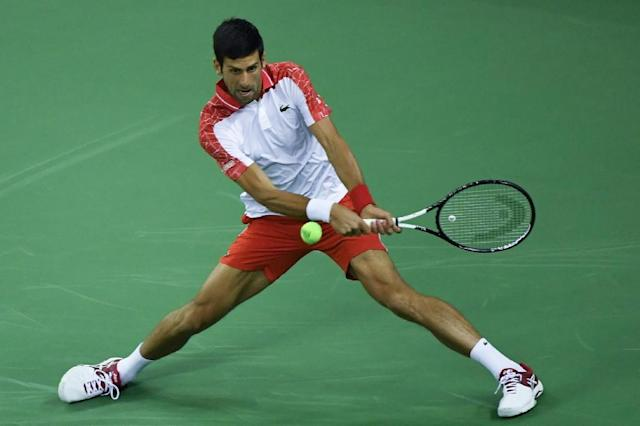 Novak Djokovic goes into round three in Shanghai after beating Frenchman Jeremy Chardy 6-3, 7-5 (AFP Photo/WANG ZHAO)