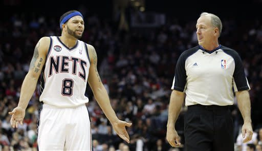 New Jersey Nets' Deron Williams (8) talks to referee Kevin Fehr during the third quarter of an NBA basketball game, Sunday, Jan. 29, 2012, in Newark, N.J. The Raptors won 94-73. (AP Photo/Julio Cortez)