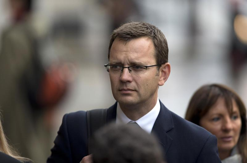 Andy Coulson, the ex-communications chief for Prime Minister David Cameron and former editor of the News of the World queues up as he arrives for his phone hacking case at the Old Bailey court in the City of London, Wednesday, Sept. 26, 2012. Eight people are appearing in court to face charges connected to the phone hacking scandal that rocked Rupert Murdoch's News Corp. empire. Rebekah Brooks, the former chief of News Corp.'s British newspapers, and Andy Coulson were among those appearing in court Wednesday. (AP Photo/Matt Dunham)