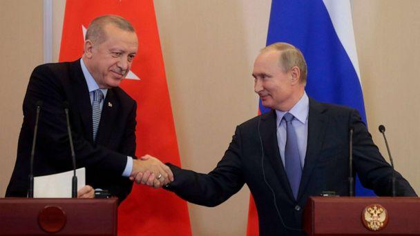 PHOTO: Russian President Vladimir Putin shakes hands with his Turkish counterpart Recep Tayyip Erdogan during a joint press conference following their talks in the Black sea resort of Sochi on Oct. 22, 2019. (Sergei Chirikov/POOL/AFP via Getty Images)