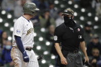 Milwaukee Brewers' Travis Shaw, left, argues with umpire Chris Segal during the fourth inning of the team's baseball game against the Atlanta Braves on Saturday, May 15, 2021, in Milwaukee. Shaw was ejected. (AP Photo/Aaron Gash)