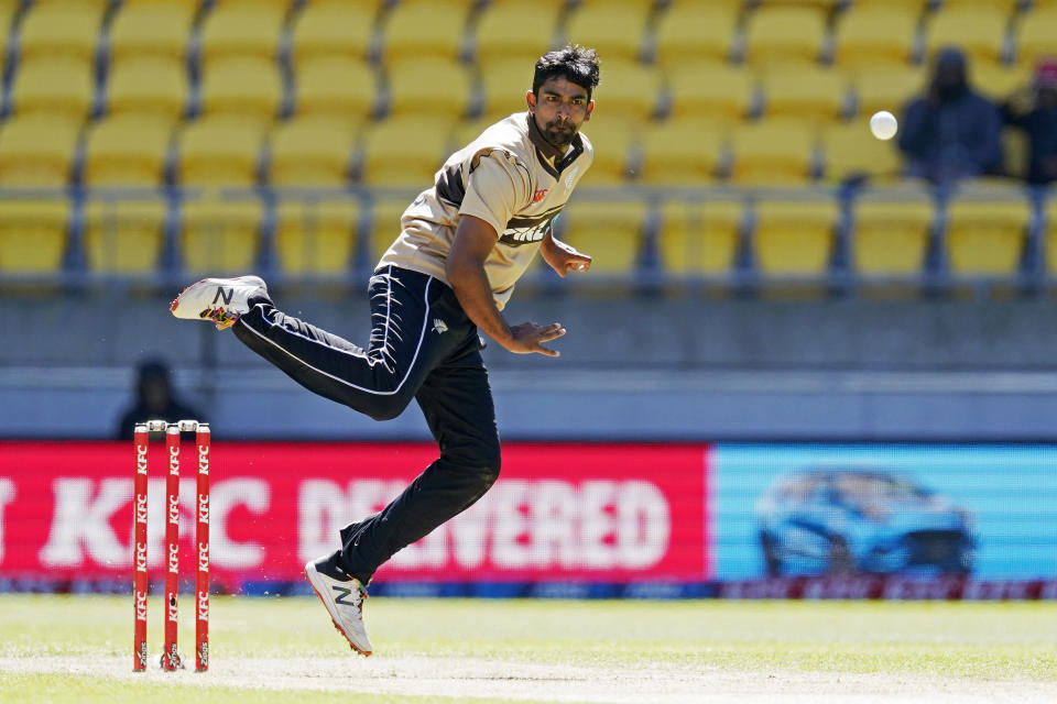 New Zealand's Ish Sodhi bowls to Australia during their 5th T20 cricket international match at Wellington Regional Stadium in Wellington, New Zealand, Sunday, March 7 , 2021. (John Cowpland/Photosport via AP)