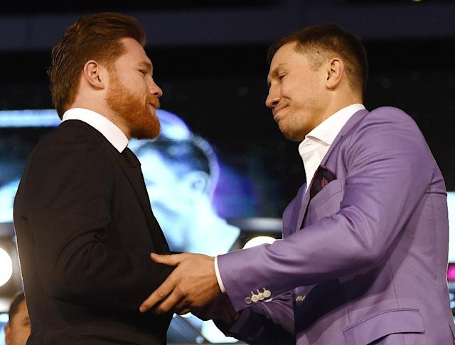 Canelo Alvarez (L) and Gennady Golovkin shake hands in February 2018 (AFP Photo/KEVORK DJANSEZIAN)